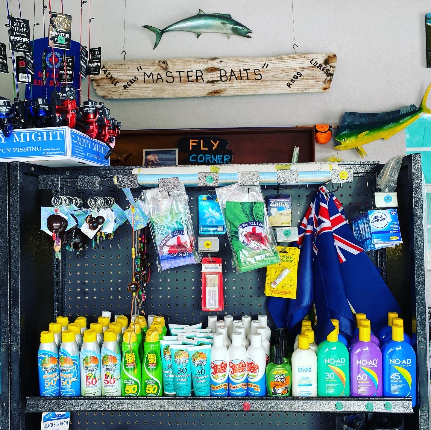 fly poles key chains sun block and the TCI flag for sale at Master Baits Tackle and Fishing shop in Scooter Bobs car rental office in Turtle Cove Turks and Caicos Islands